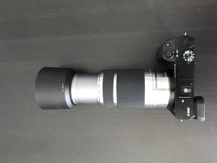 The 55-210mm lens on the a6000 extended with hood